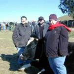 Regina, Chris, and Nicole with bovine friend