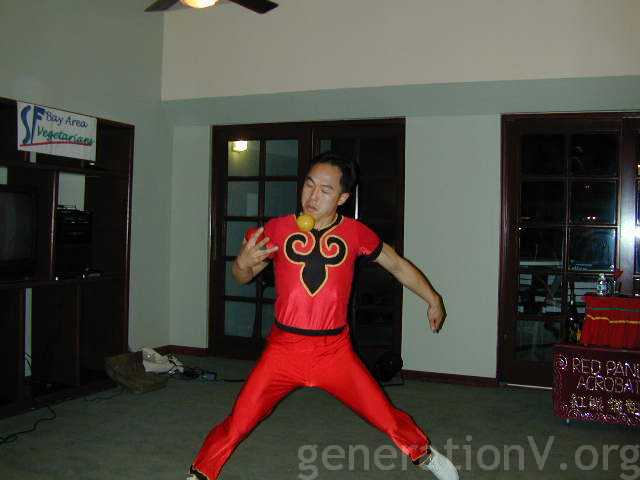 Wayne dressed as a red acrobat