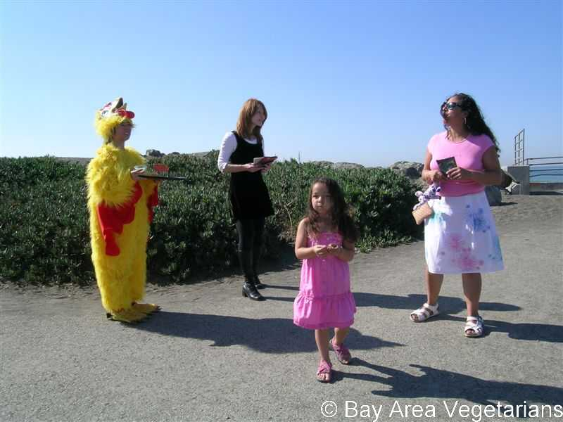 Tammy in chicken costume with Elizabeth leafleting
